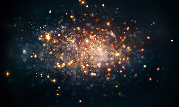fire sparkles bokeh background - paranormaal stockfoto's en -beelden
