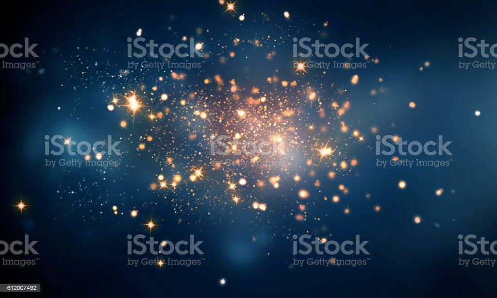 fire sparkles in dark blue bokeh background - Photo de Bleu libre de droits