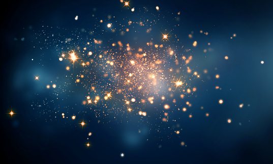 istock fire sparkles in dark blue bokeh background 612007492