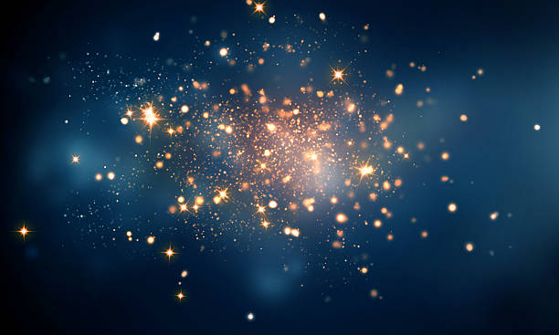 fire sparkles in dark blue bokeh background - goldener glitzer stock-fotos und bilder