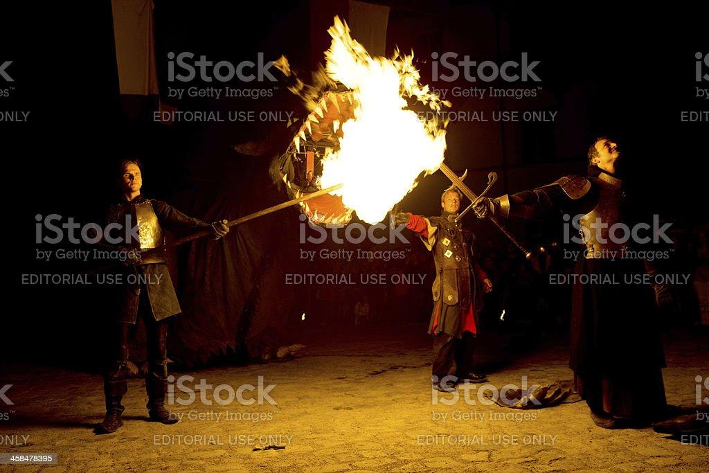 fire spouting dragon fighting hero royalty-free stock photo