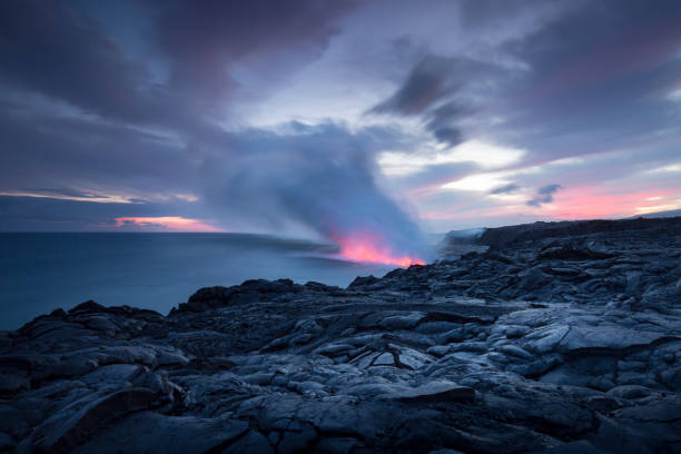 Fire sunset and lava flow Sunset over a recent lava flow and volcanic eruption on the Big Island of Hawaii volcanic landscape stock pictures, royalty-free photos & images