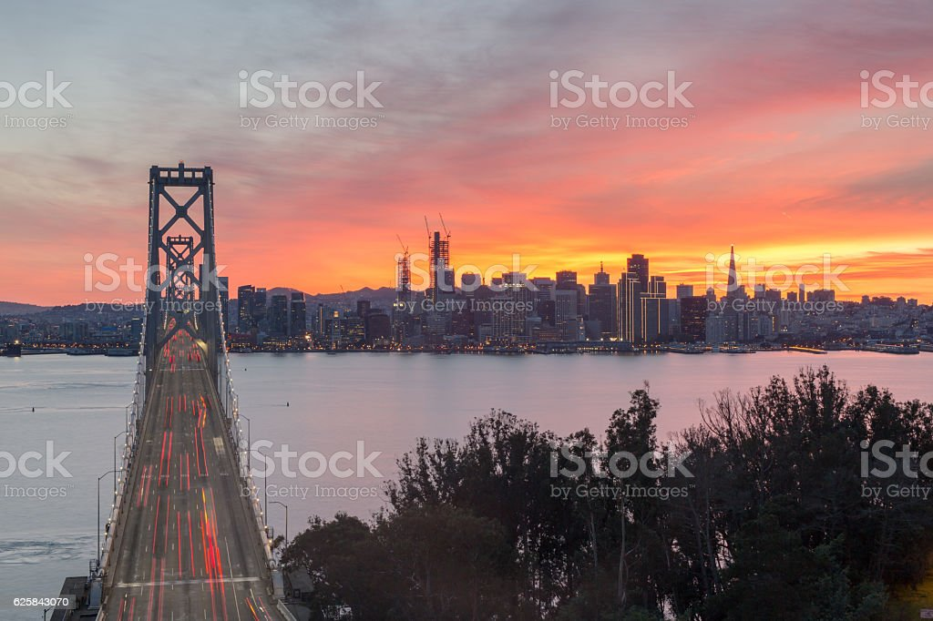 Fire Sunset over the Bay Bridge and San Francisco Downtown stock photo