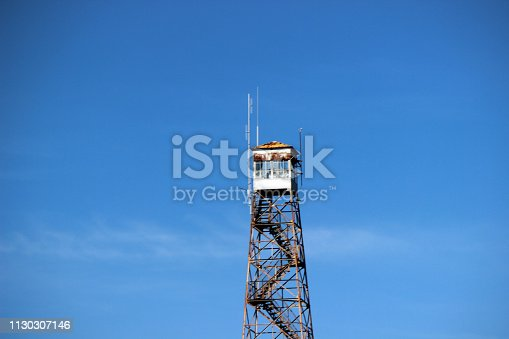 A fire tower structure for observation of forest fires. Photographed near Belhaven, North Carolina, in Beaufort County near a portion of the intracoastal waterway.