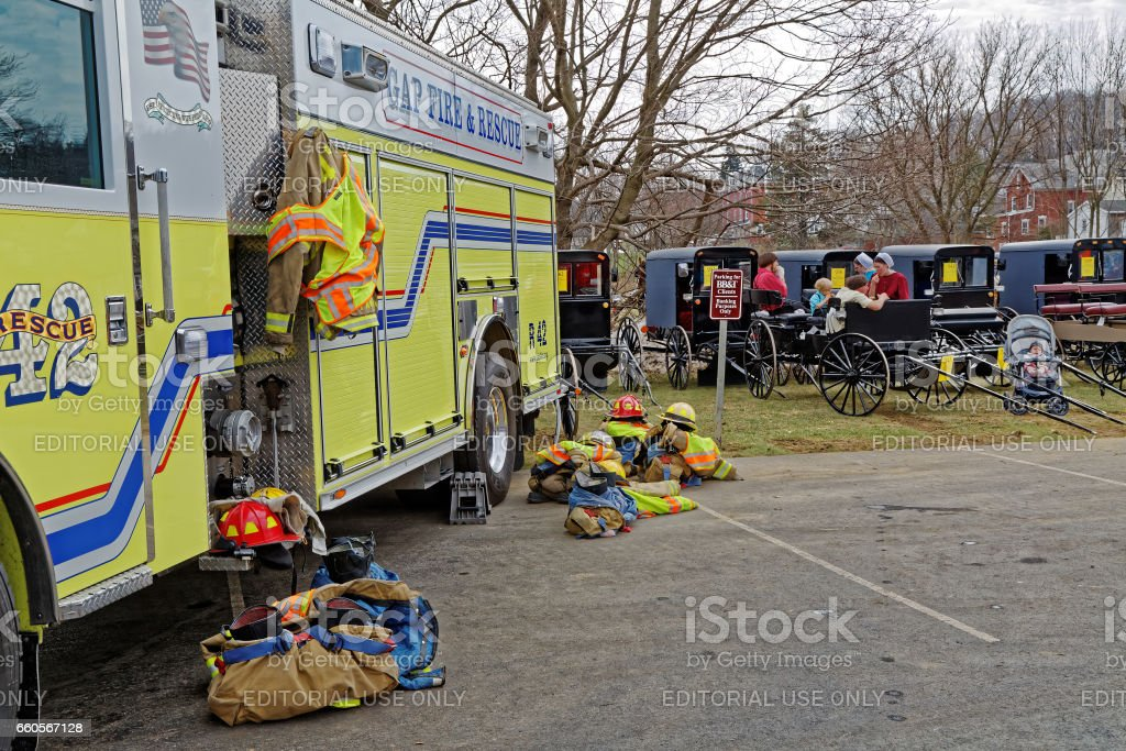Fire Truck and Amish Carriages at Lancaster County Benefit Auction stock photo