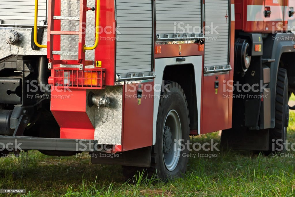 Fire truck close-up. Element of a body of a red car. Truck on the...