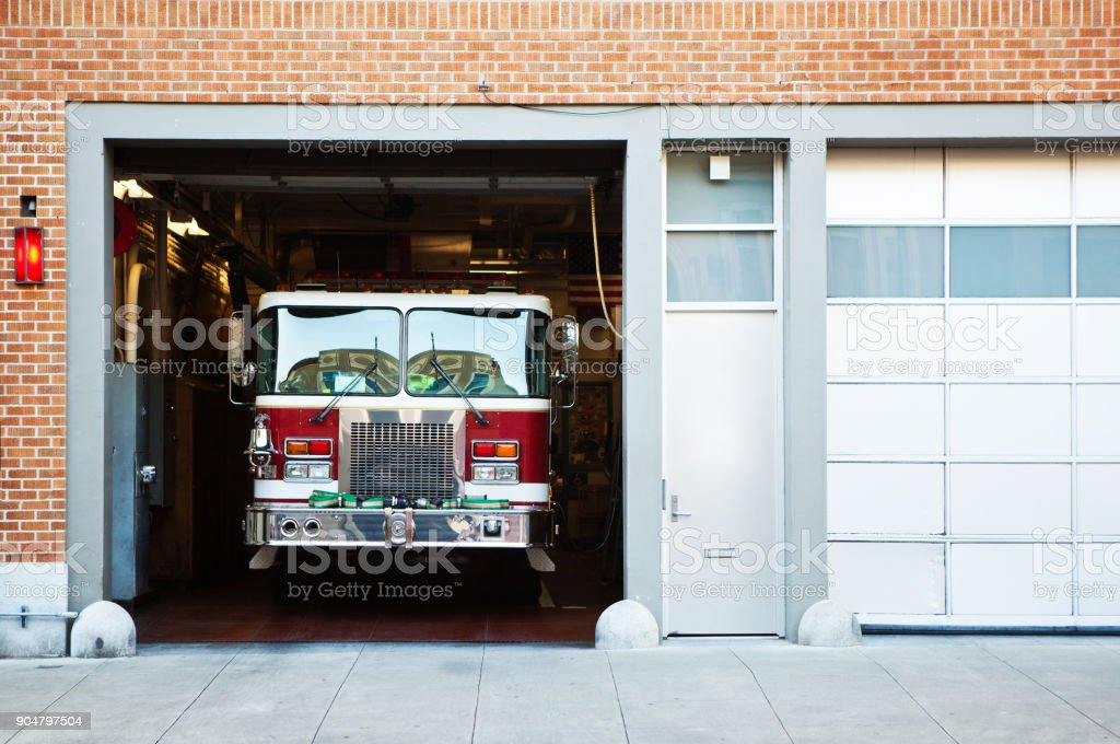 Fire truck in fire station. stock photo