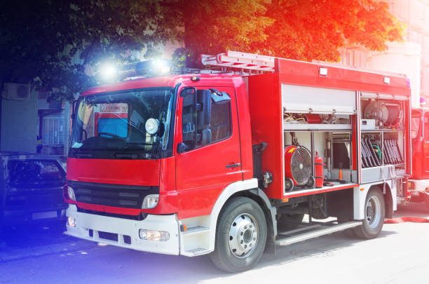 Fire Truck in situation with flashing lights stock photo