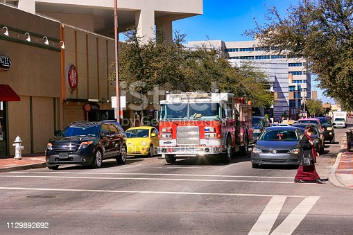 Fire truck in the middle lane of traffic in downtown Tucson Arizona
