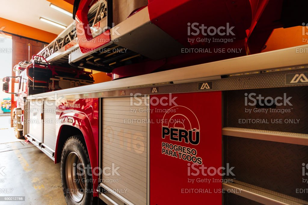 Fire Truck Parked In A Firehouse With The Inscription Peru