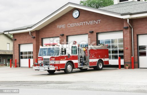 fire truck in front of fire station