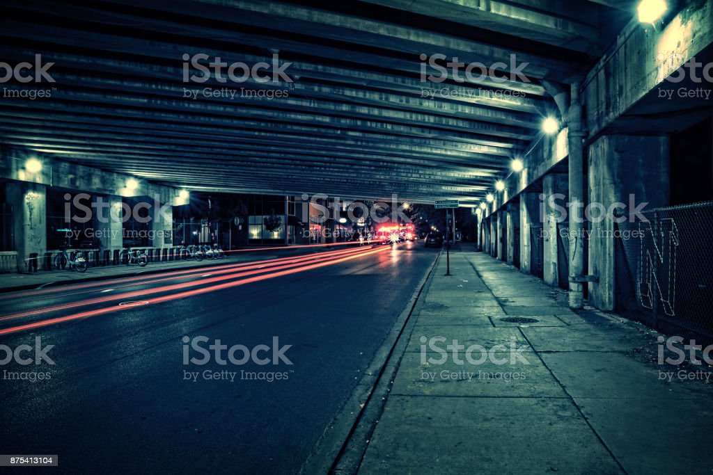 Fire trucks, ambulance, police and traffic in a dark Chicago tunnel viaduct street at night. stock photo
