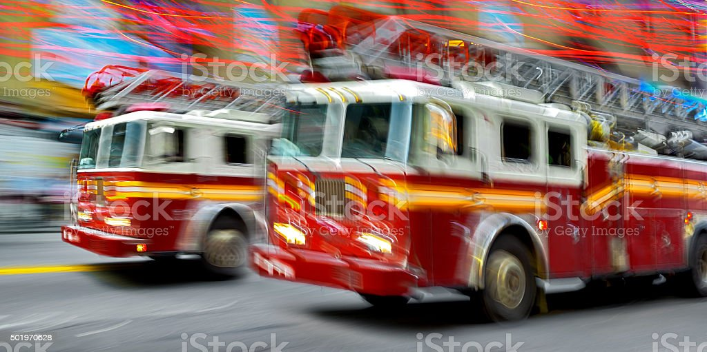 fire trucks and firefighters brigade in the city stock photo
