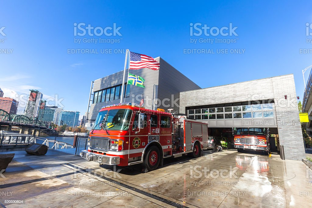 fire trucks stop in fire station in portland stock photo