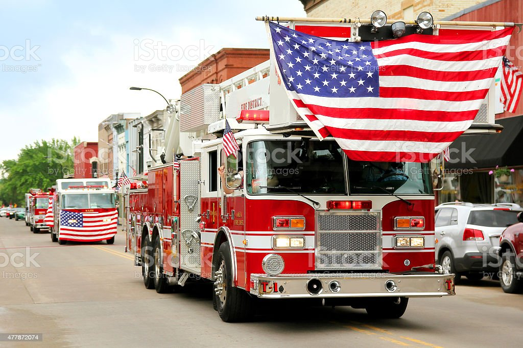 Fire Trucks with American Flags at Small Town Parade stock photo