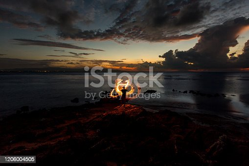 Fire Twirl at Sunset