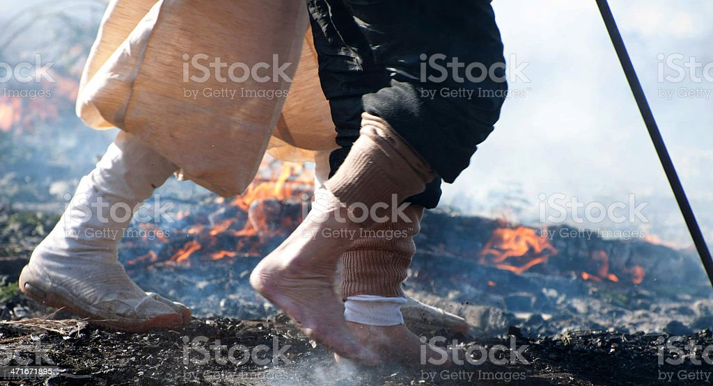 Fire Walking On Hot Coals Walking on hot coals at a Japanese Fire Festival on Mt. Takao in Japan. Asia Stock Photo