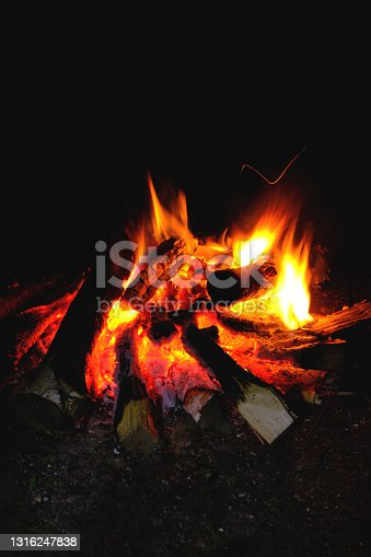 Fire was lit, hot coals in the fire from the burning logs