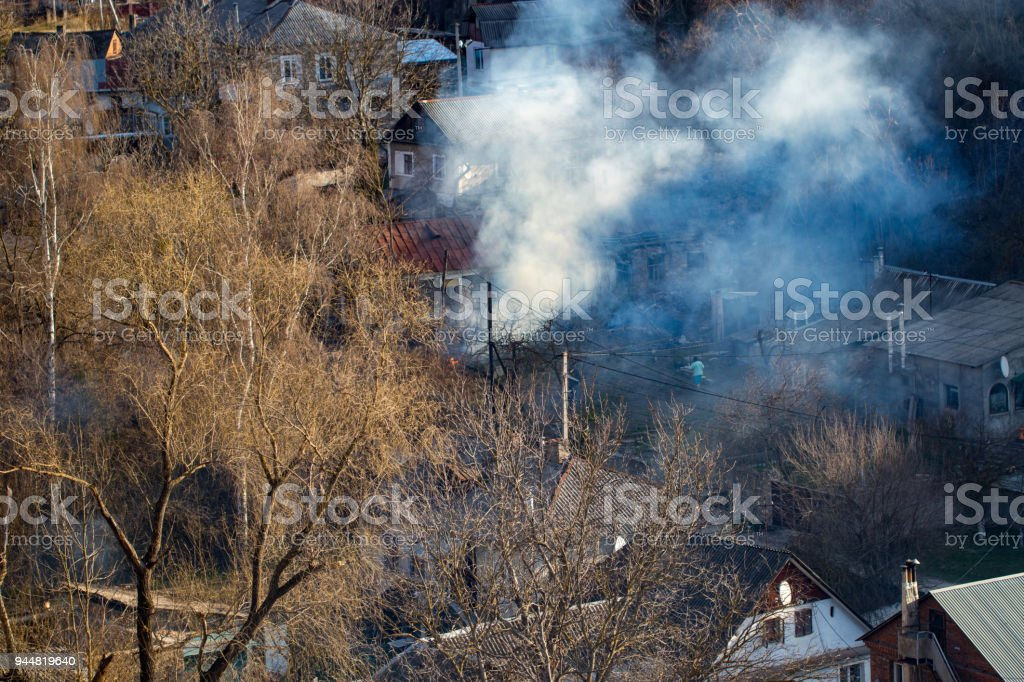 Fire with black smoke in house. House in smoke stock photo