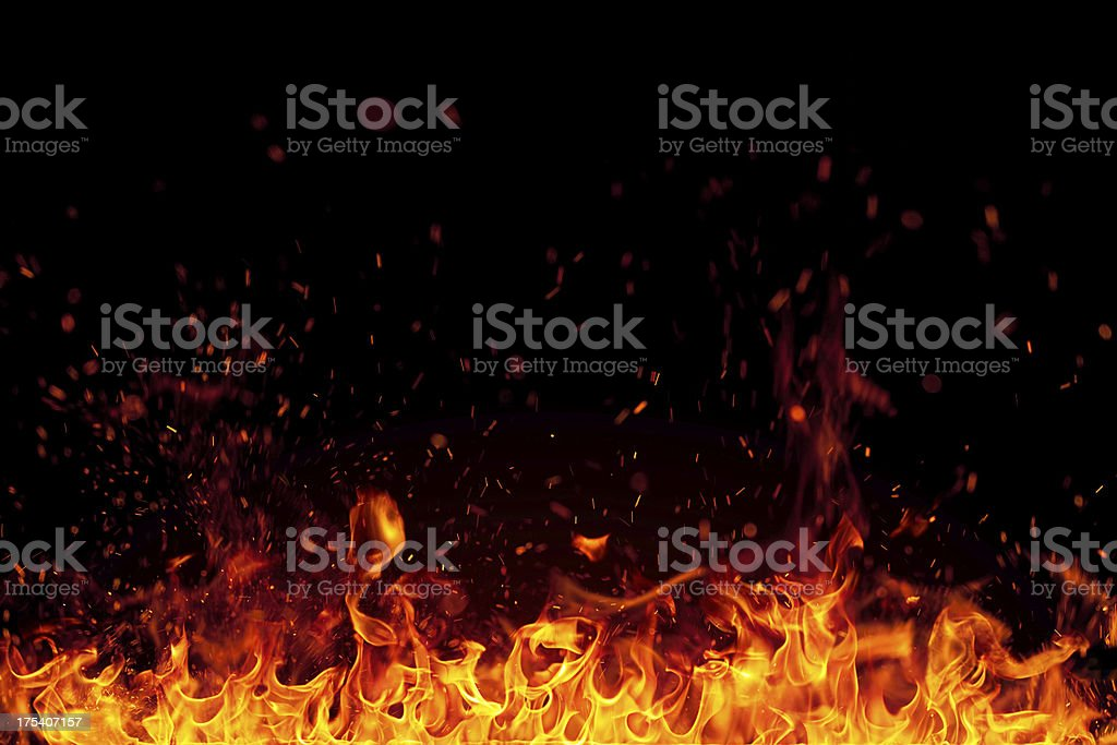 Fire with bright sparks isolated on black background stock photo