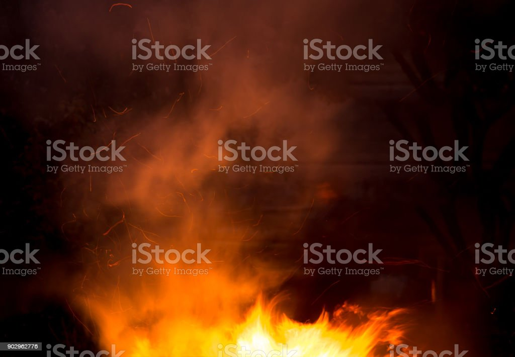 fire with smoke on a black background stock photo