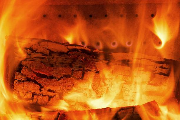 Fire wood burns in a fireplace stock photo