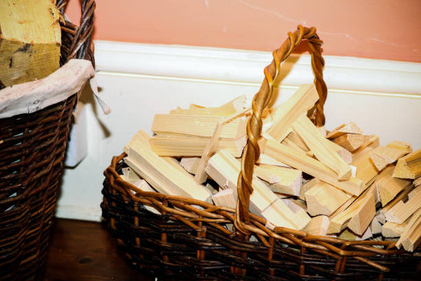 Fire wood in a basket stock photo