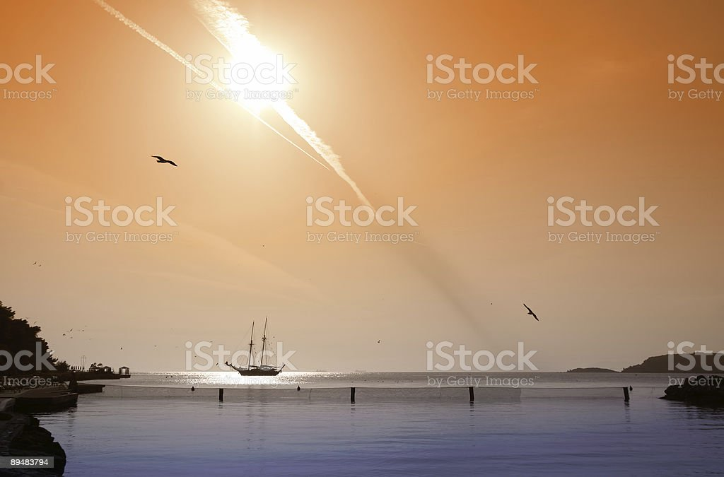 Fireball above a tranquil bay stock photo