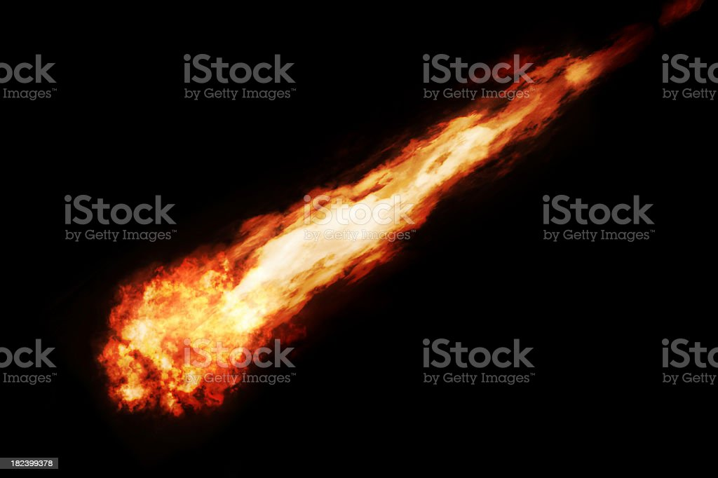 Fireball streaking across black sky stock photo