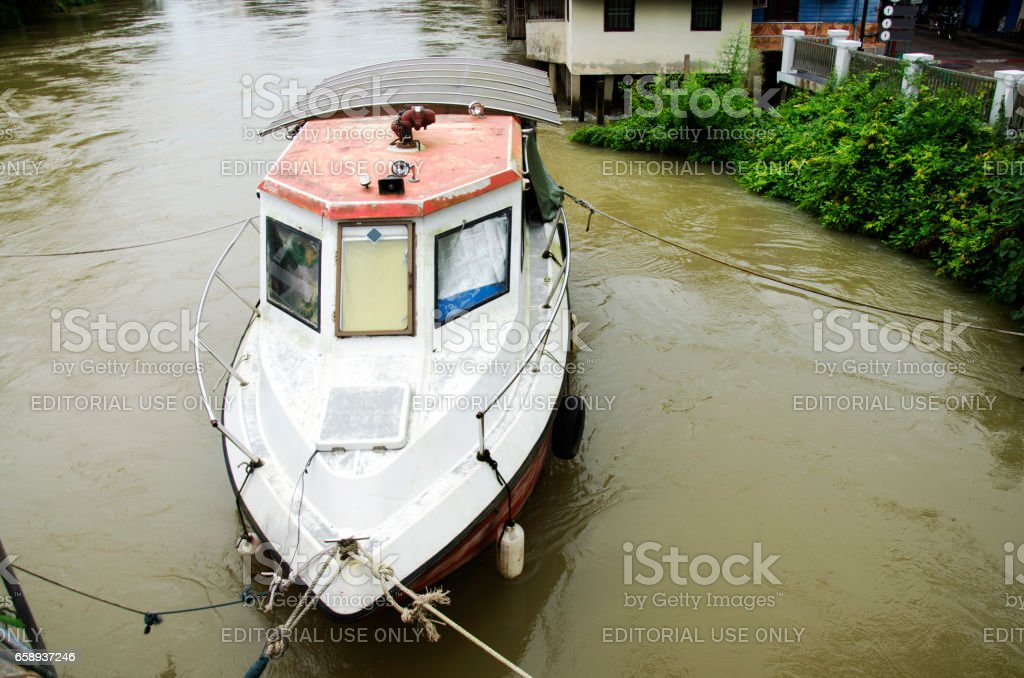 Fireboat floating chanthaburi river while water fast and severe stock photo