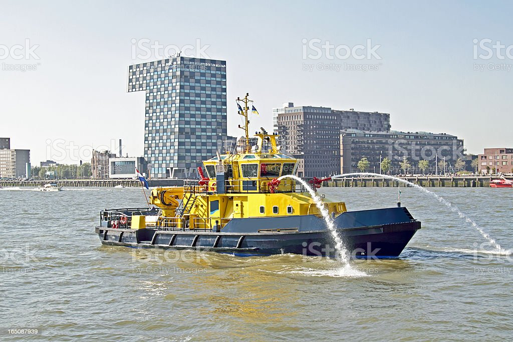 Fireboat in the harbor from Rotterdam Netherlands stock photo