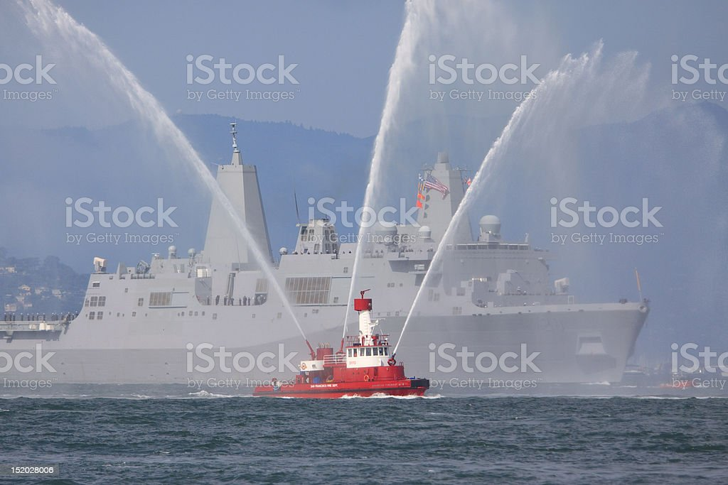 Fireboat with Naval Ship stock photo