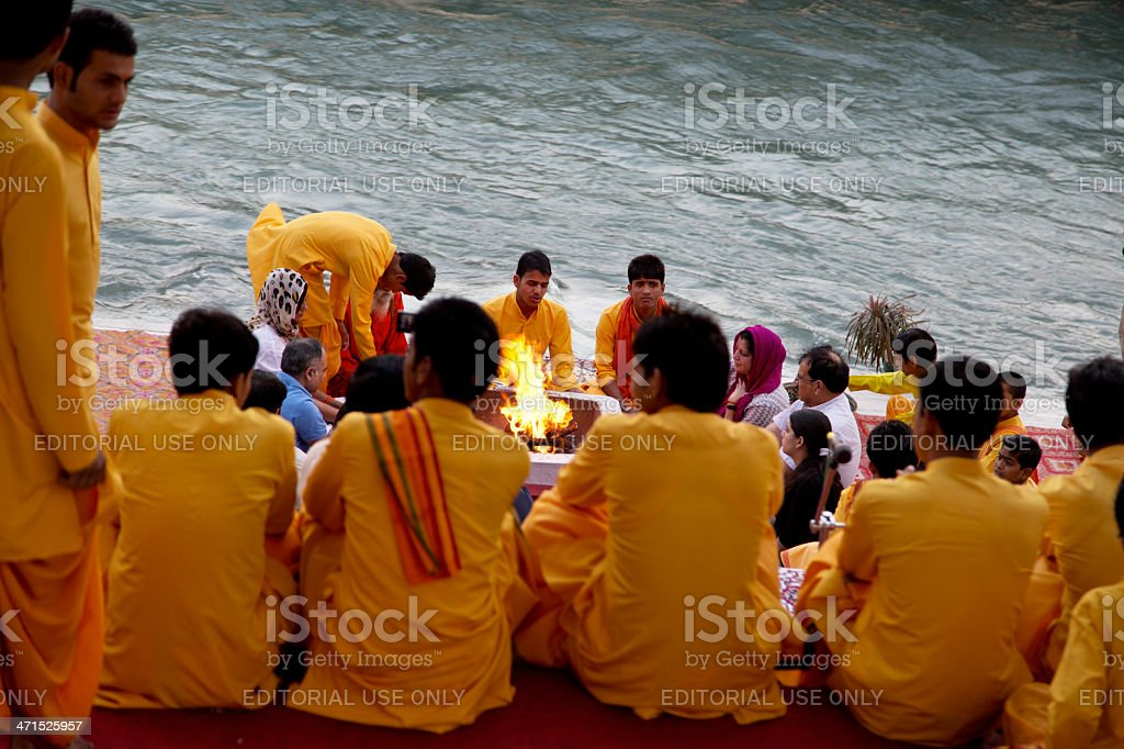 Fire-ceremony-on-the-holy-river-Ganges-in-Rishikesh-India stock photo