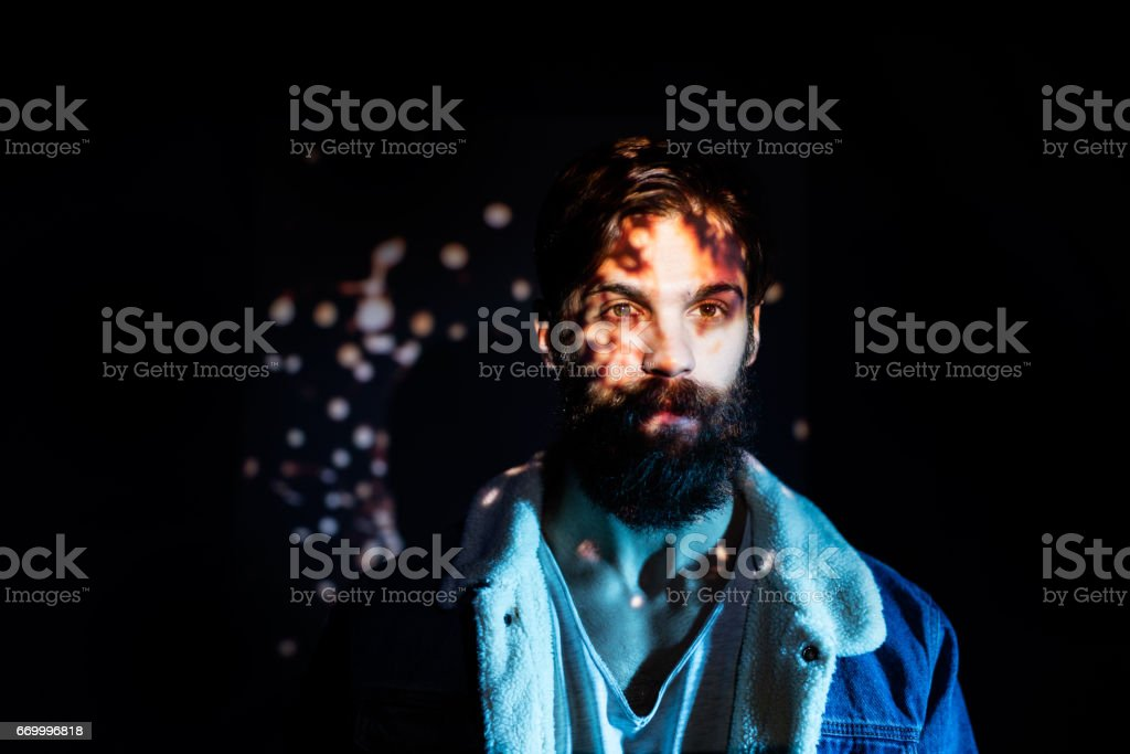 Firecracker spark image projected on a young man upper body stock photo