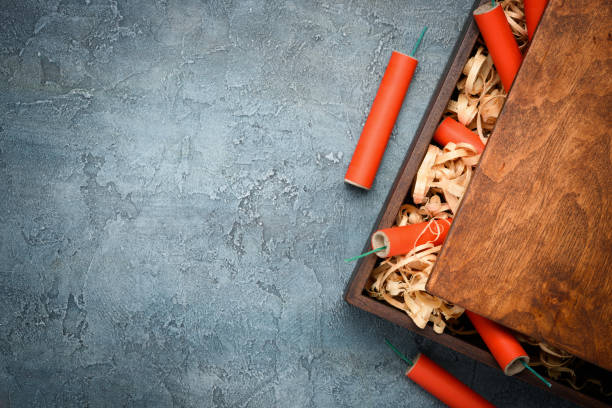 firecrackers in wooden box - petard stock photos and pictures