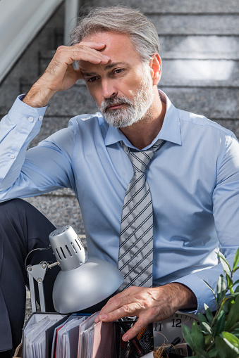 1048789678 istock photo Fired businessman 1045867716