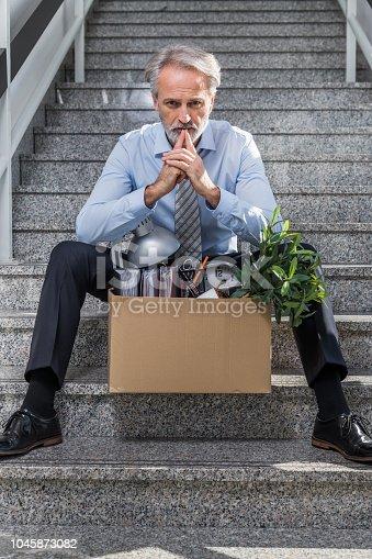 1048789678istockphoto Fired businessman 1045873082