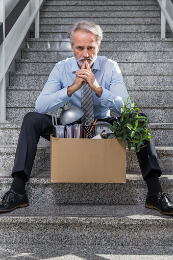 1048789678 istock photo Fired businessman 1045873082