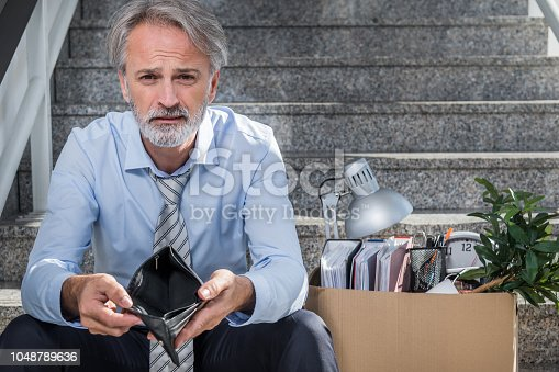 1048789678istockphoto Fired businessman 1048789636