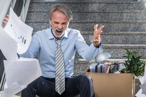 1048789678 istock photo Fired businessman 1048789664