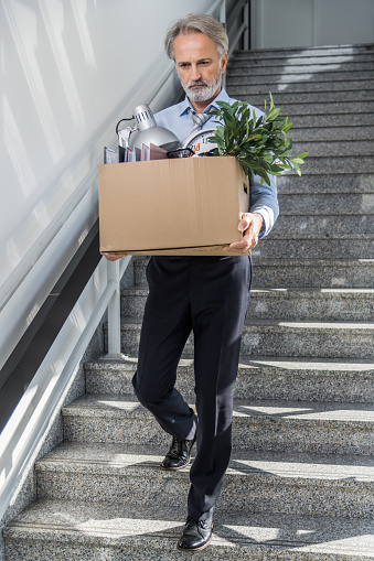 1048789678 istock photo Fired businessman 1125637891