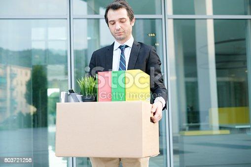 1181817161 istock photo Fired businessman taking away his belongings in wall street 803721258