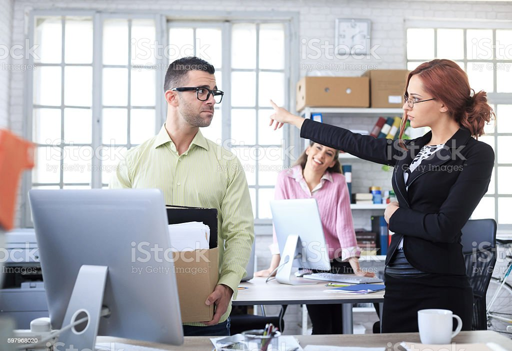 Fired man leaving workplace stock photo