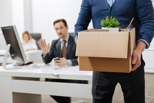 istock Fired senior employee leaving the office with the box 655913628