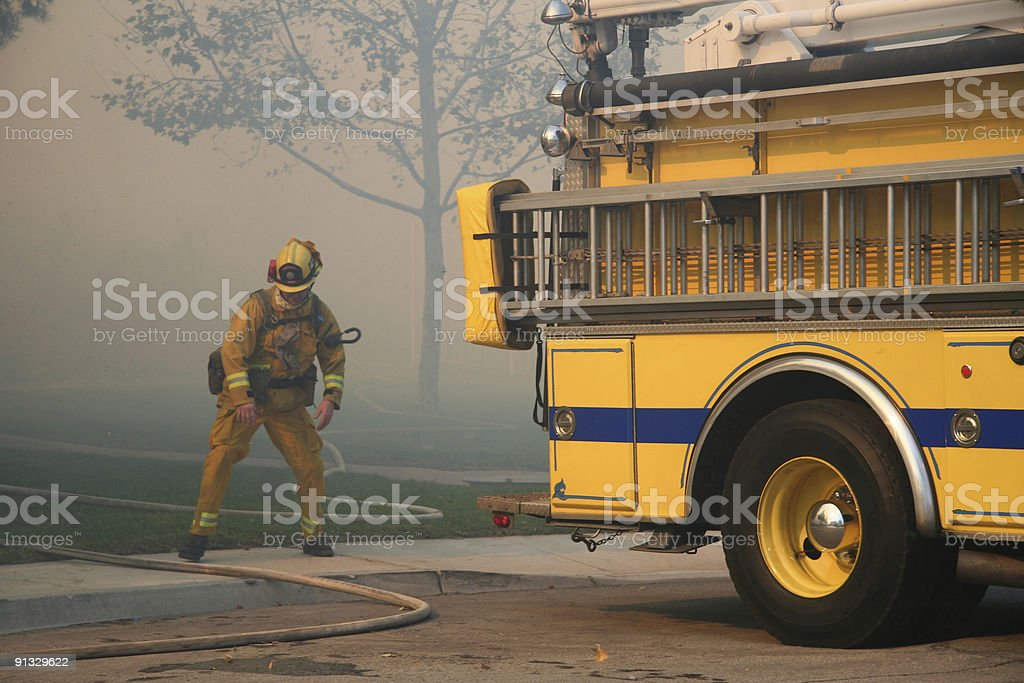 Firefighter and truck royalty-free stock photo