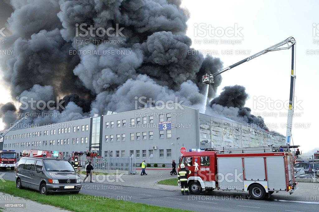 Firefighter crews battling storehouse fire stock photo