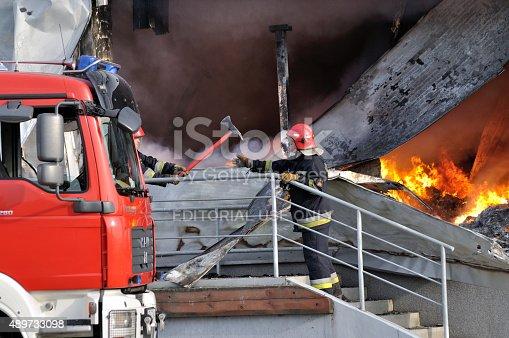 istock Firefighter crews battling storehouse fire 489733098