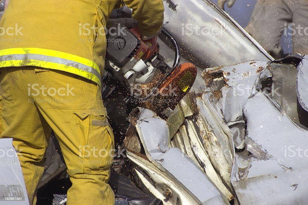 Firefighter cutting vehicle open stock photo