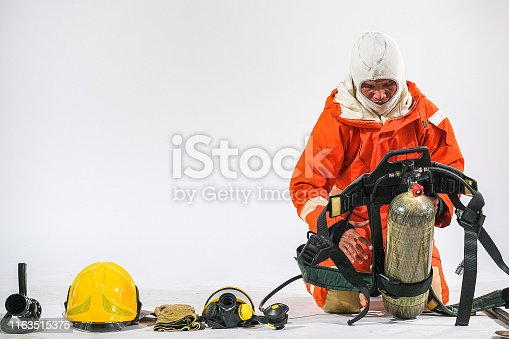 istock Firefighter demonstrates wearing uniforms, helmets and various equipment to prepare firefighters on a white background. 1163515375