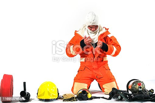 istock Firefighter demonstrates wearing uniforms, helmets and various equipment to prepare firefighters on a white background. 1169517468